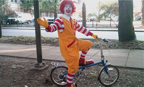 Clown on Small Bike