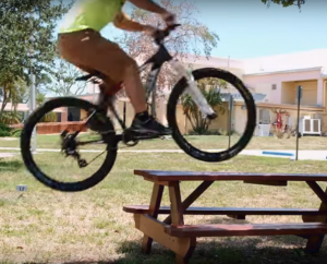 Biking over picnic table