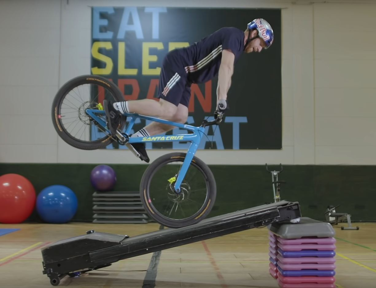 Danny MacAskill riding a bike on a treadmill.