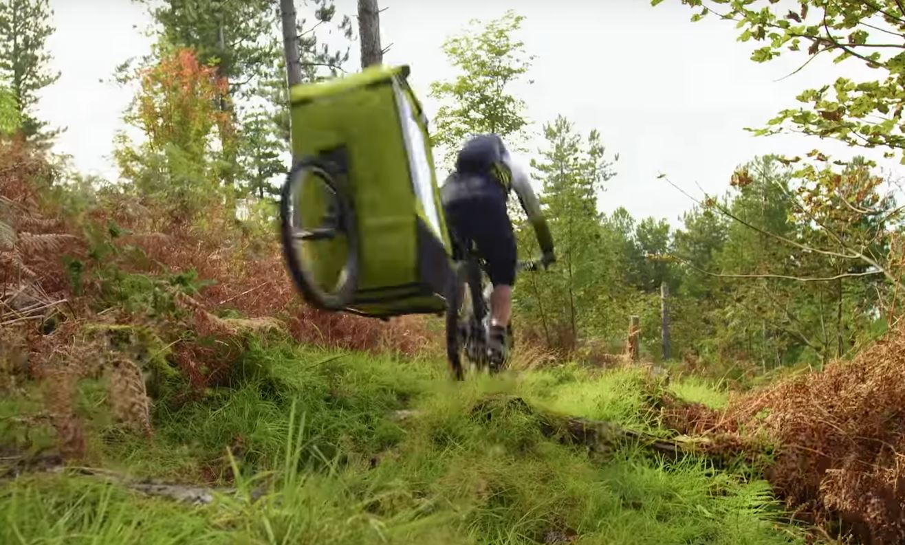 Danny MacAskill jumping a bike trailer.