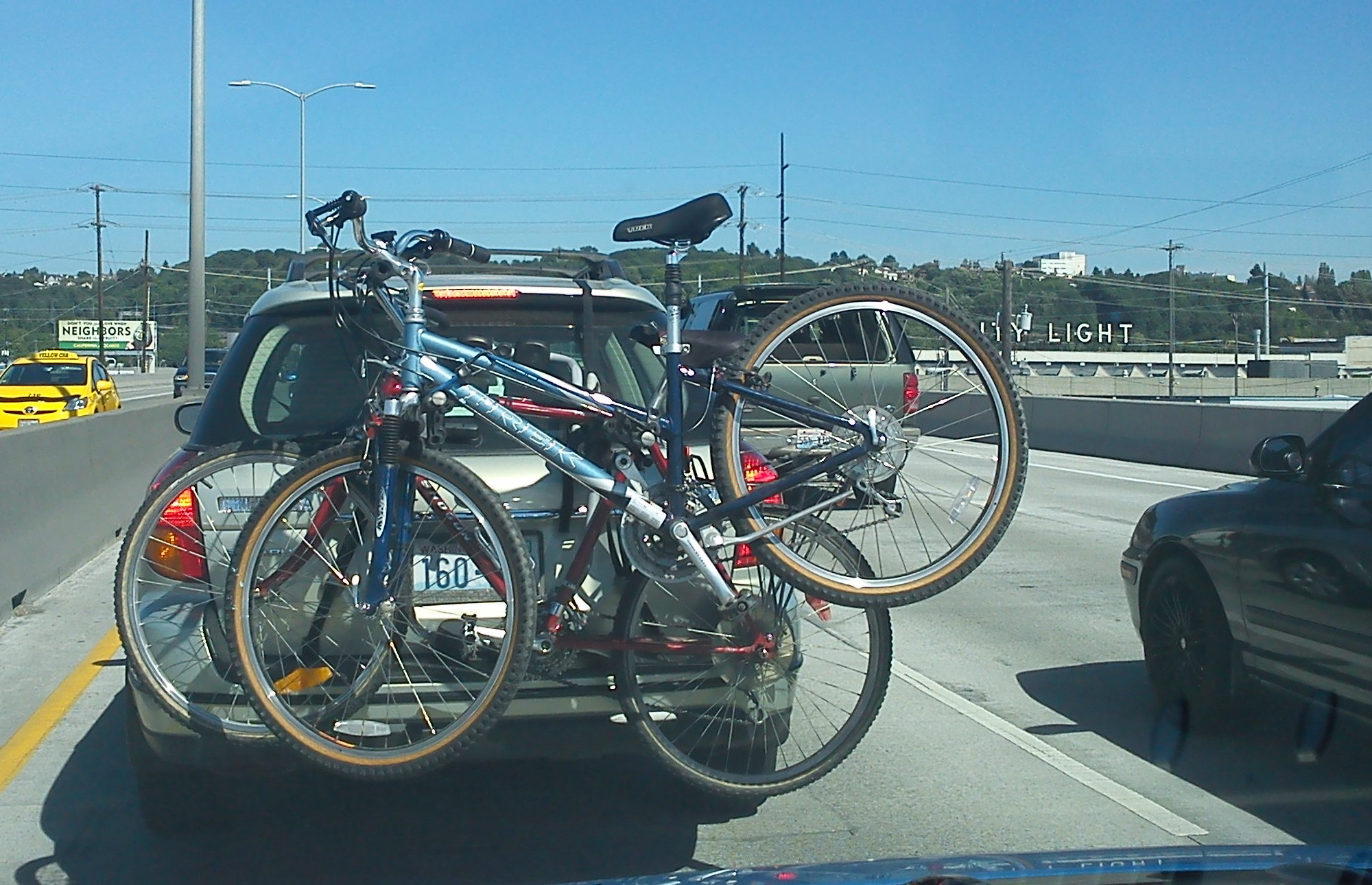 dangerously mounted bikes on a car rack