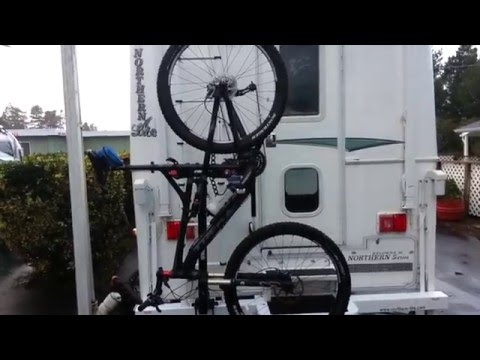 bike hanging precariously (and in the way) from RV