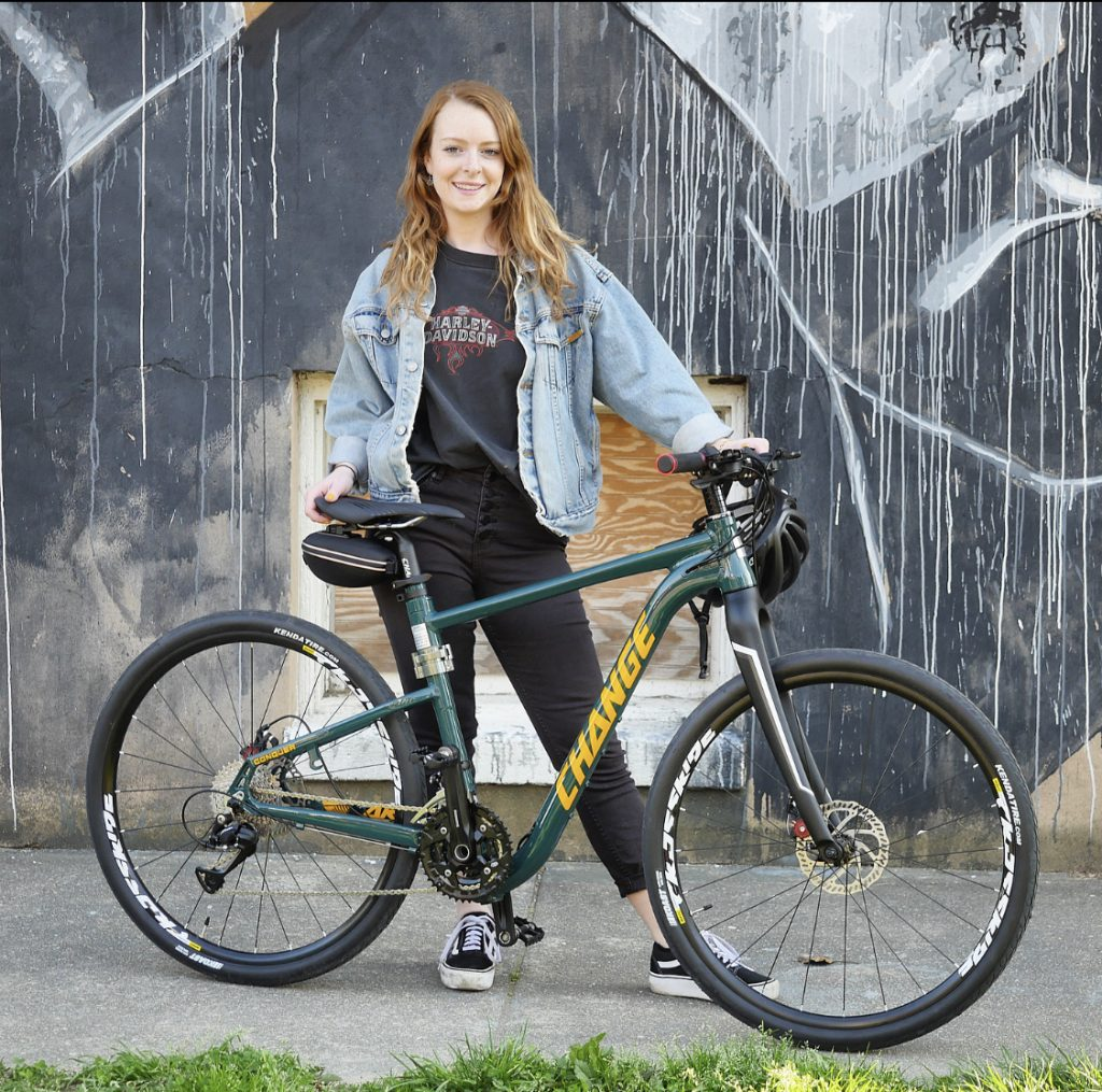 cyclist with folding hybrid bike