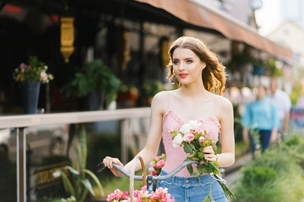 young woman with flowers and a bike