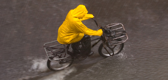 winter riding cyclist commuting in a downpour