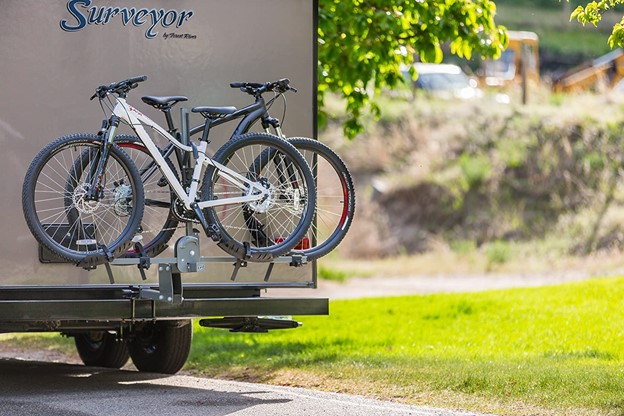 bikes stuck on the outside of an rv