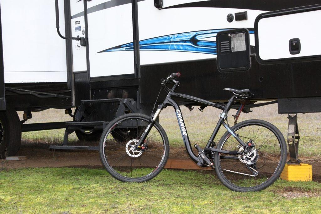 Folding CHANGE bike next to an RV